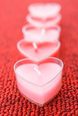 Pink candles in form of heart — Stock Photo
