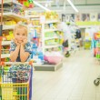 Little beautiful girl in supermarket — Stock Photo