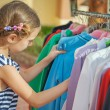 Beautiful girl choose right clothes — Stock Photo