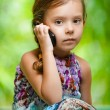 Little girl calling on mobile phone — Stock Photo