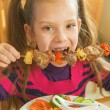 Beautiful smiling girl eating kebab — Stock Photo