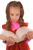 Little girl in red dress and with book — Stock Photo