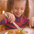 Girl-preschooler eats a tasty meal — Stock Photo