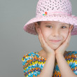 Smiling little girl in cap — Stock Photo