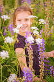 Little girl walks on blossoming meadow — Stock Photo