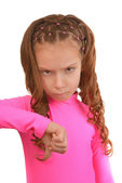 Little girl in pink dress puts thumb down — Stock Photo