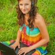 Woman young beautiful laptop headphones — Stock Photo #31019597