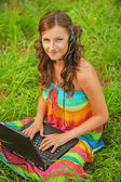 Woman young beautiful laptop headphones — Stock Photo