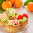 Cakes and mandarins — Stock Photo