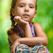 Girl sitting on wooden table — Stock Photo #31081885