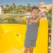 Little girl near water park slides — Stock Photo #31081933