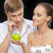 Young couple with apple — Stock Photo