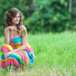 Stock Photo: Young beautiful womsitting on grass
