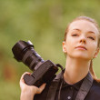 Young woman photographs on camera — Stock Photo #31196175