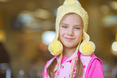 Little girl smiling in yellow hat — Stock Photo