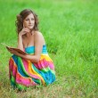 Portrait of beautiful woman holding book — Stock Photo #31243413
