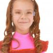 Little girl in pink dress sly smile — Stock Photo