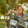 Little cheerful girl on old bike — Stock Photo