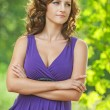 Young woman in purple dress thought — Stock Photo