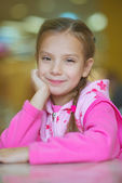 Girl-preschooler sitting at table — Stock Photo