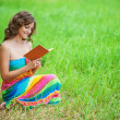 Portrait of beautiful woman holding book — Stock Photo #33482043