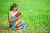 Portrait of beautiful woman holding book — Stock Photo