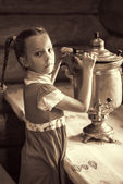 Little girl with samovar — Stock Photo