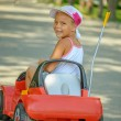 Little girl riding toy car — Stock Photo