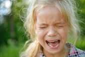 Sad little girl crying — Stock Photo