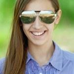 Beautiful girl in sunglasses — Stock Photo