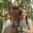 Smiling young woman close-up with horse — Stock Photo