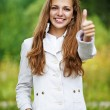 Smiling beautiful woman lifts thumbs upwards, — Stock Photo #39315317
