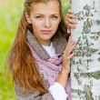 Beautiful young woman near birch — Stock Photo