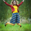 Stock Photo: Beautiful womwith dreadlocks jumping