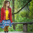 Stock Photo: Woman with dreadlocks sitting on bench