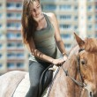 Beautiful young woman on horseback — Stock Photo #40292465