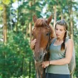 Young woman close-up with horse — Stock Photo #40294935