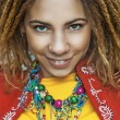 Stock Photo: Smiling beautiful womwith dreadlocks