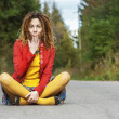 Woman with dreadlocks sits in lotus position — Stockfoto