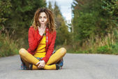 Woman with dreadlocks sits in lotus position — Stock Photo