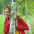 Foto de Stock  : Womwith dreadlocks near birch