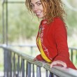 Womwith dreadlocks near wooden railing — Stock Photo #40490953
