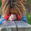 Stock Photo: Womwith dreadlocks crying