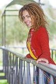 Woman with dreadlocks near wooden railing — Stockfoto