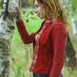 Womwith dreadlocks near birch — Stock Photo #40713113