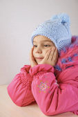 Little girl in warm coat with cap — Stock Photo