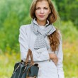 Nice young woman with handbag — Stock Photo #40898479