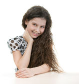 Beautiful girl behind table — Stock Photo