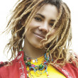 Smiling beautiful woman with dreadlocks — Stock Photo