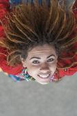 Smiling beautiful woman with dreadlocks — Stock Photo
